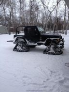 Jeep-Wrangler-on-Snowmobile-Tracks.jpg