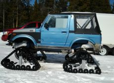 Suzuki-Sidekick-on-Snowmobile-Tracks.jpg